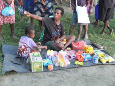 Woman selling in an informal market in Wewak, East Sepik Province, PNG, 2014